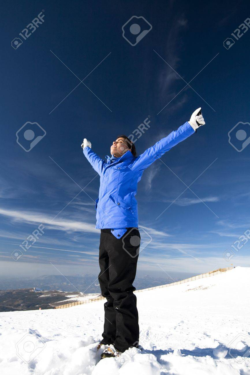 Portrait of happy young woman dressed for skiing. Stock Photo - 9371772