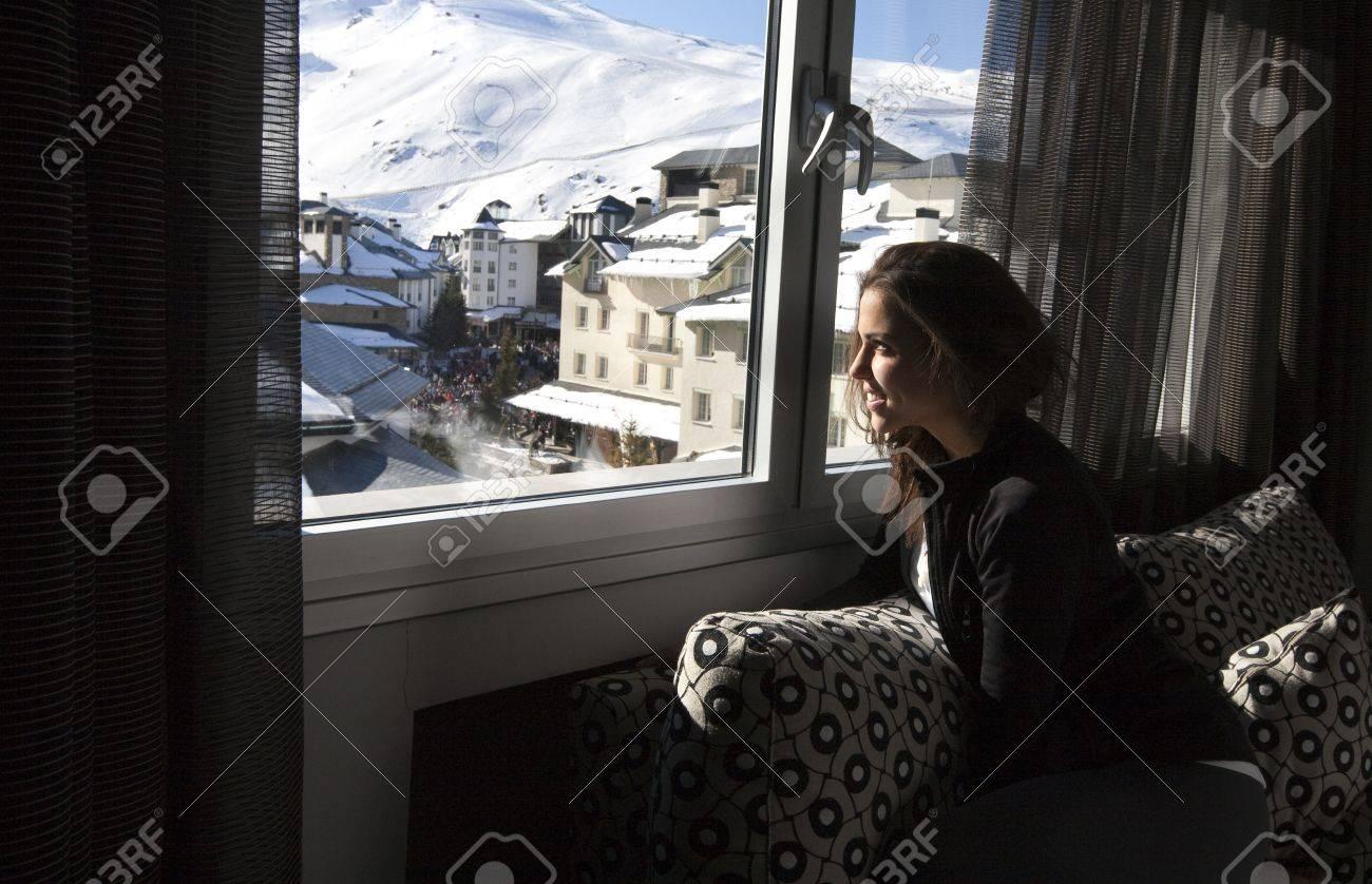 Young girl looking through the window to the  Sierra Nevada Ski Resort, Granada. Stock Photo - 9371774