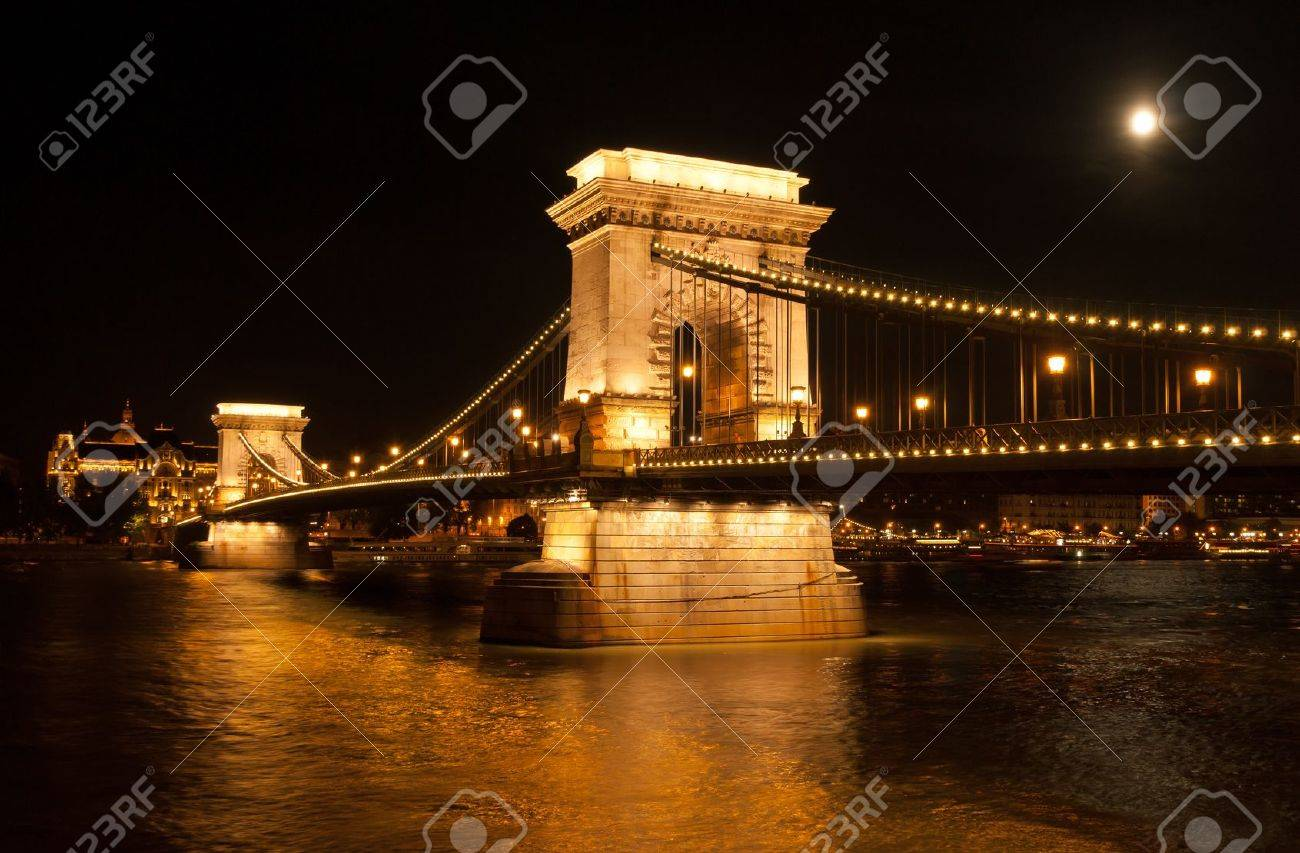 The Chain Bridge with the Gresham Palace and Danube river in Budapest at full moon - Hungary at night Stock Photo - 15436924