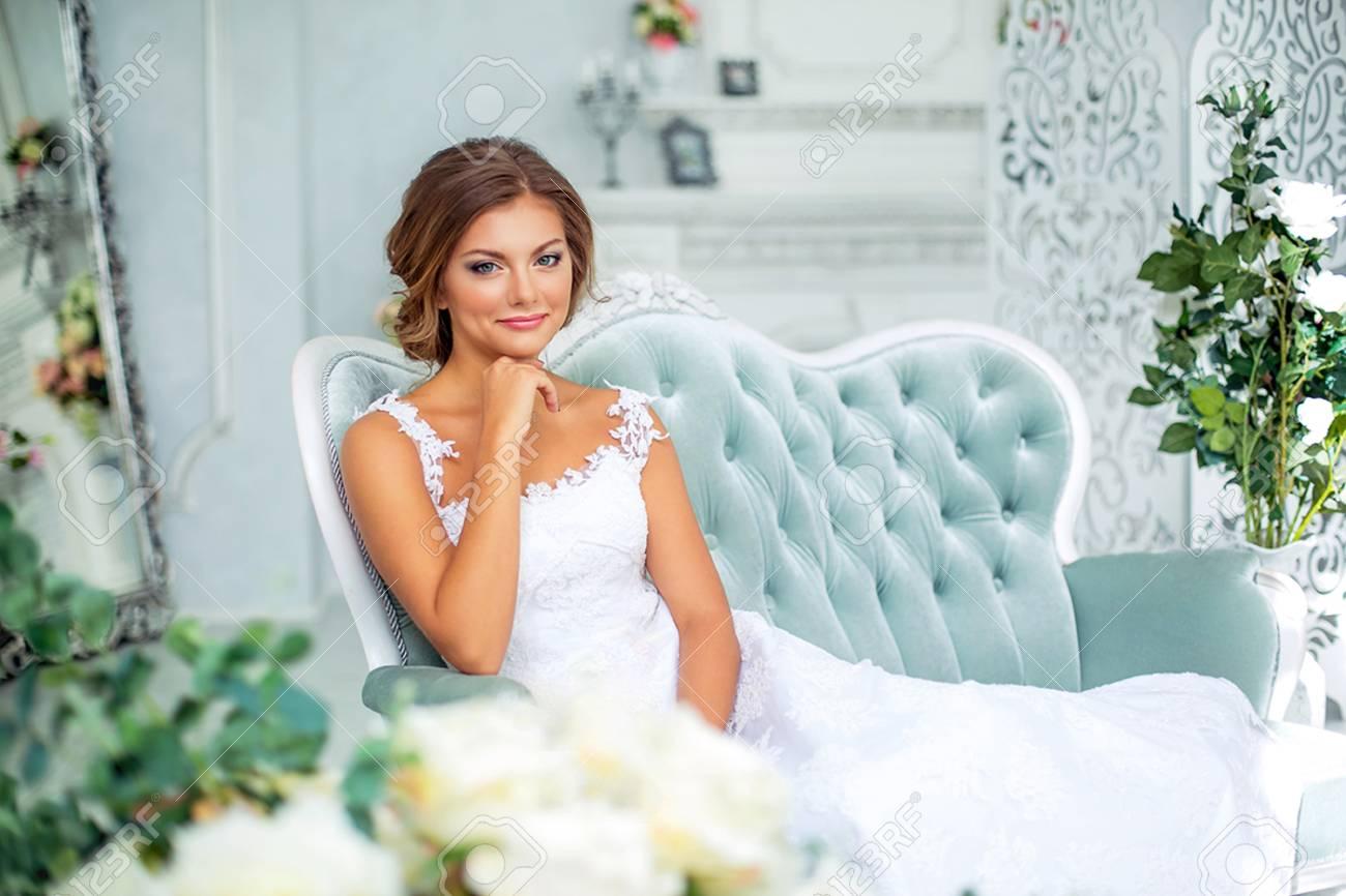 Beautiful, Gentle Bride In White Wedding Dress In Luxury Bright ...