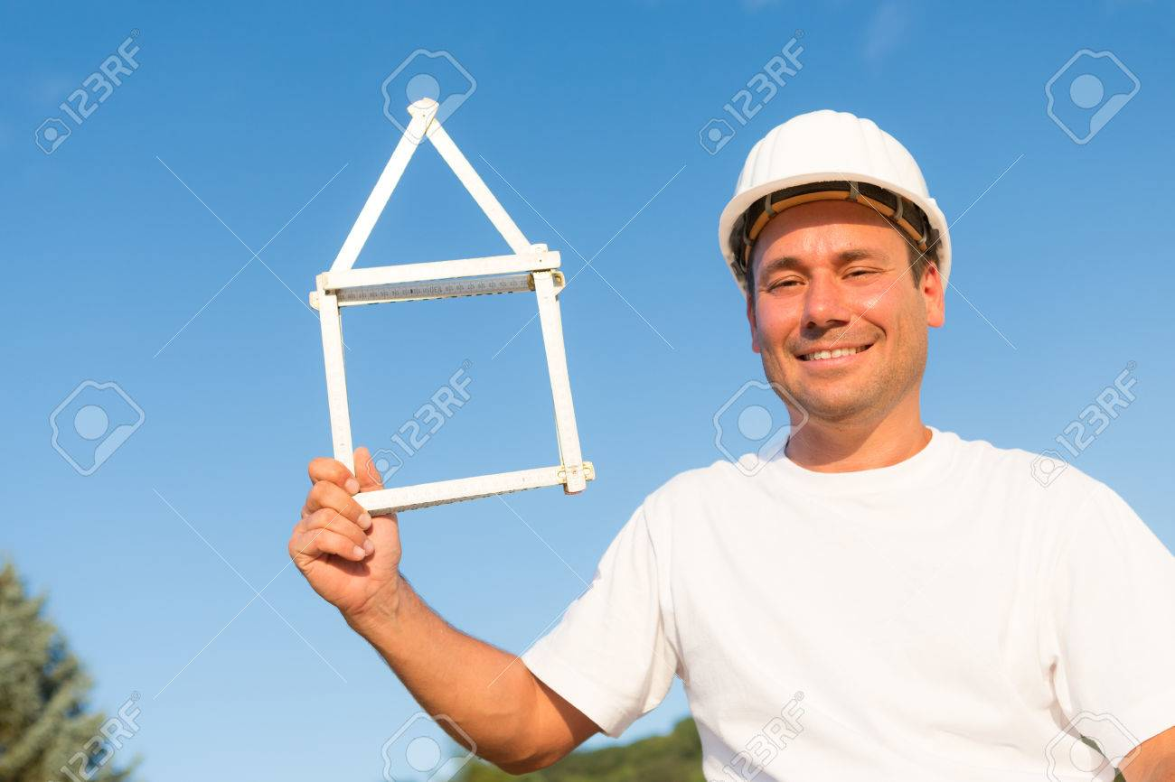 Stock Photo   Young Man Who Uses A Measure To Form His Dream House