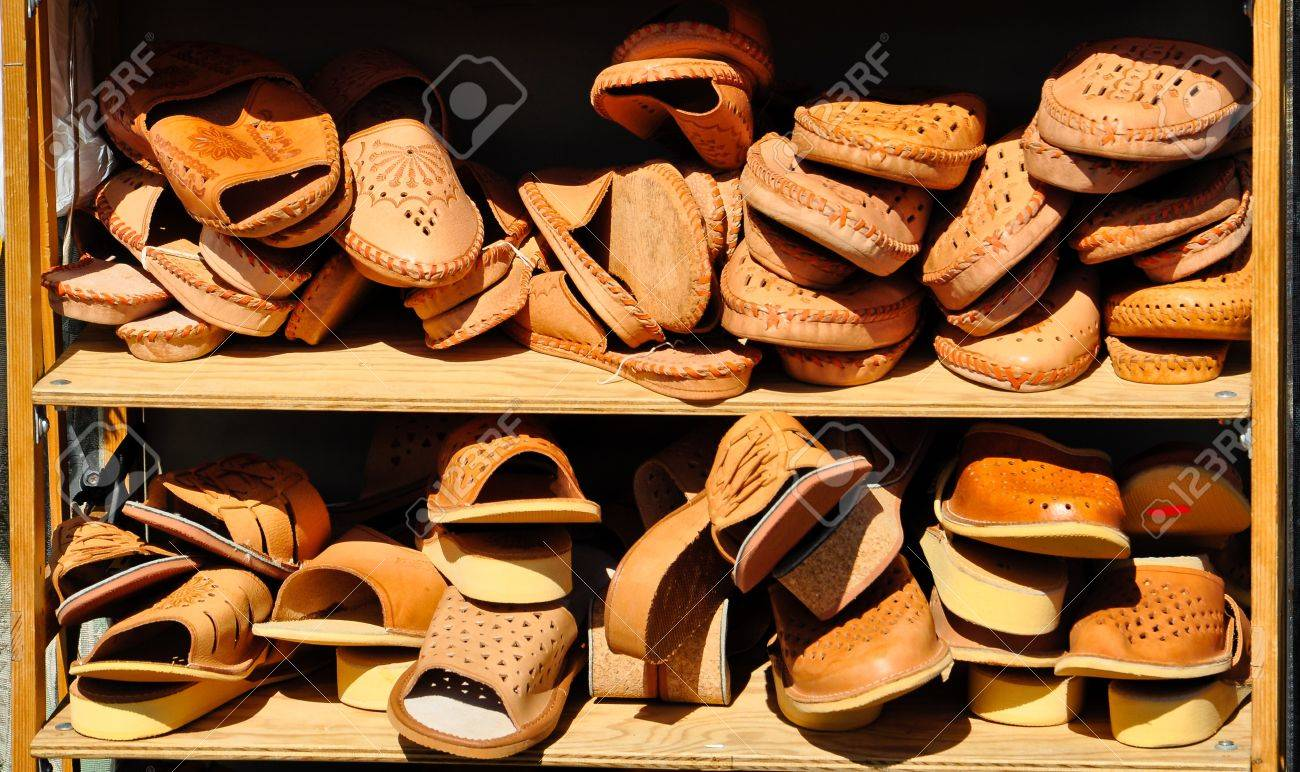 2851055db7f4c display of brown leather shoes and sandals on a rack at a local market in  vienna