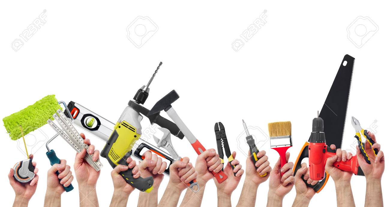 Hands holding tools - 65315488