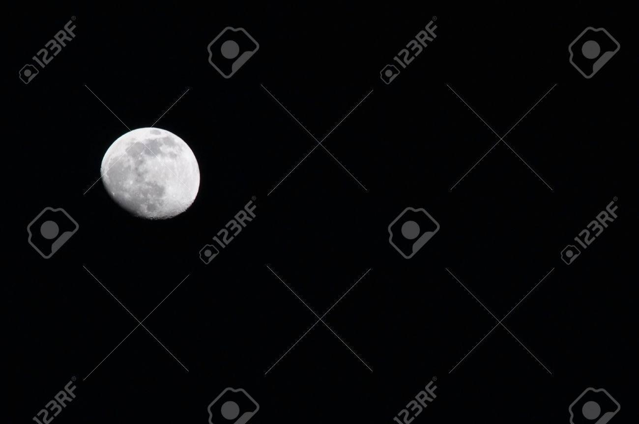 The moon on dark blackground Stock Photo - 8076441