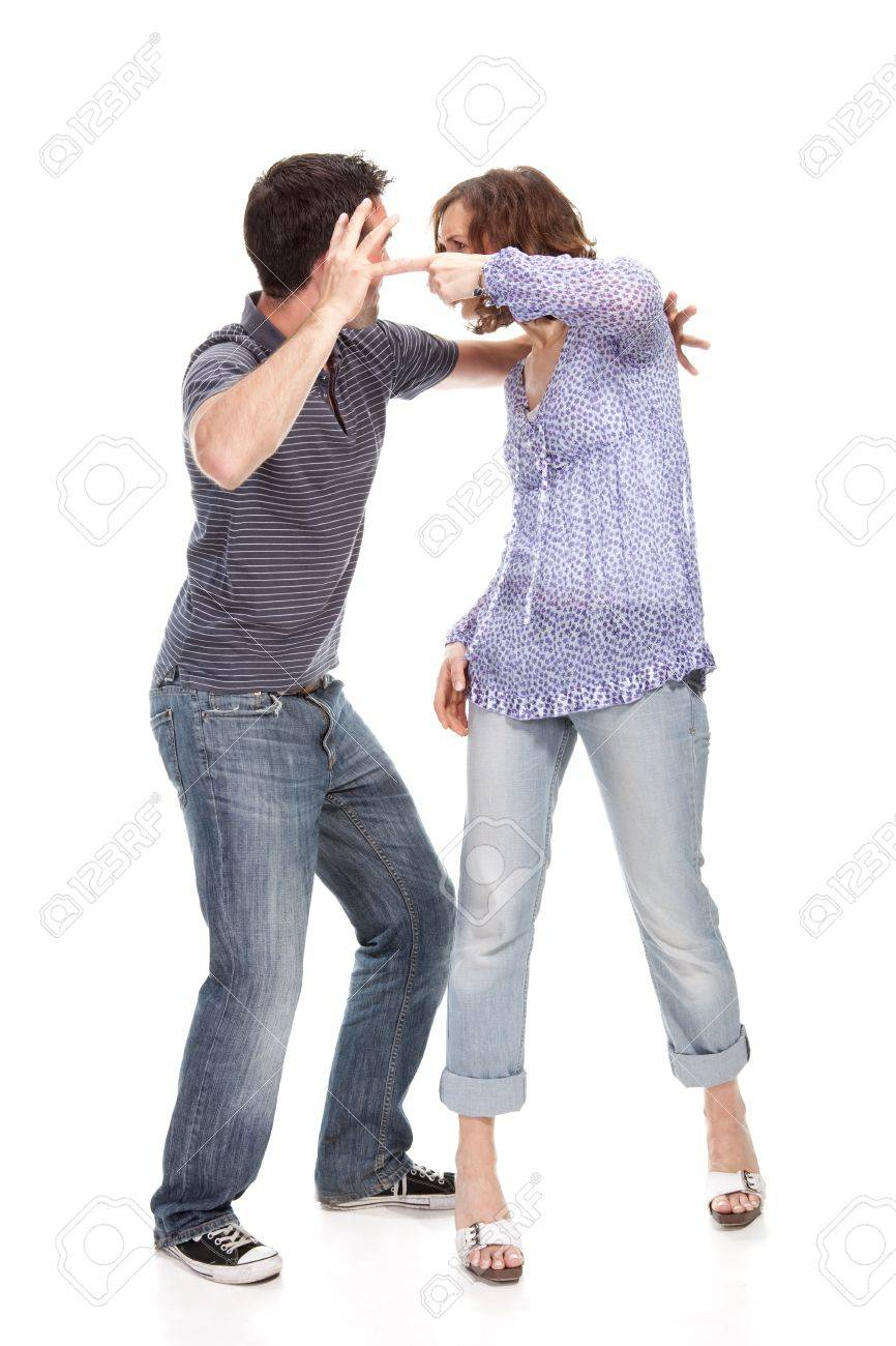 Angry couple yelling at each other  isolated over white background Stock Photo - 5052537
