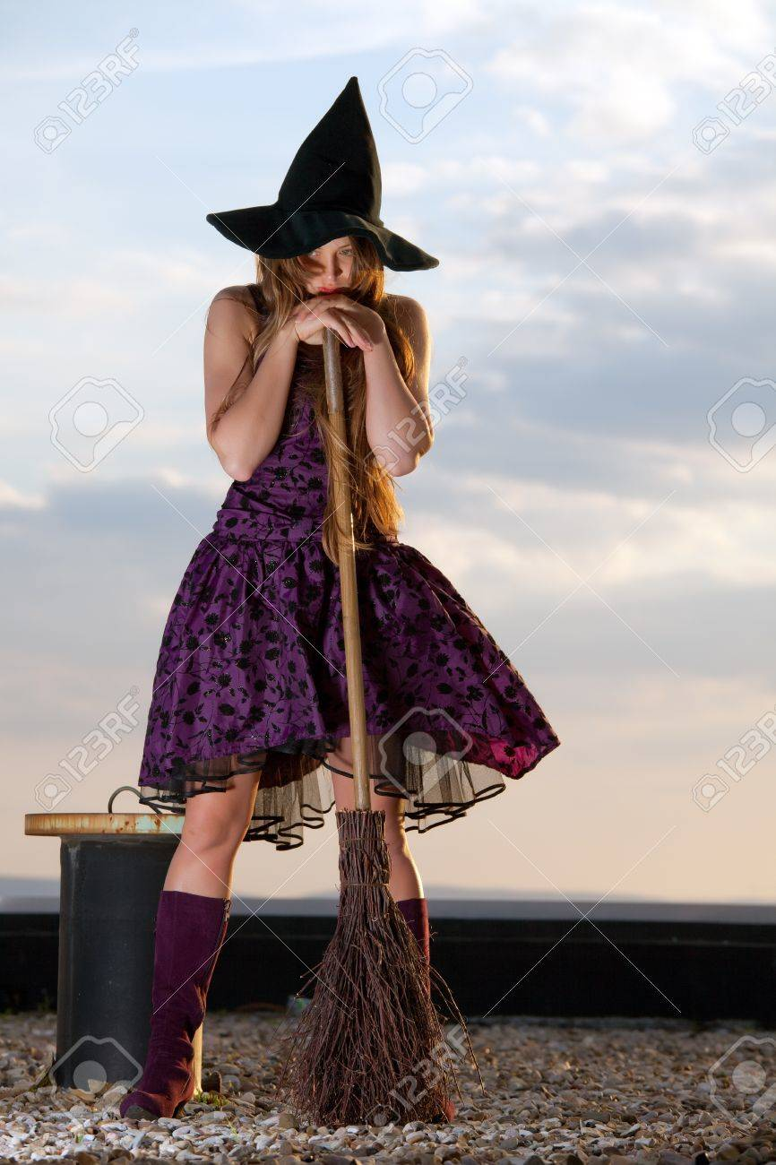 pretty witch with hat and broom stock photo picture and royalty