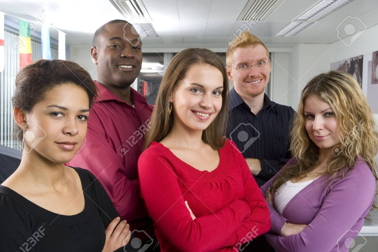 Multi-ethnic co-workers posing in office Stock Photo - 4518374