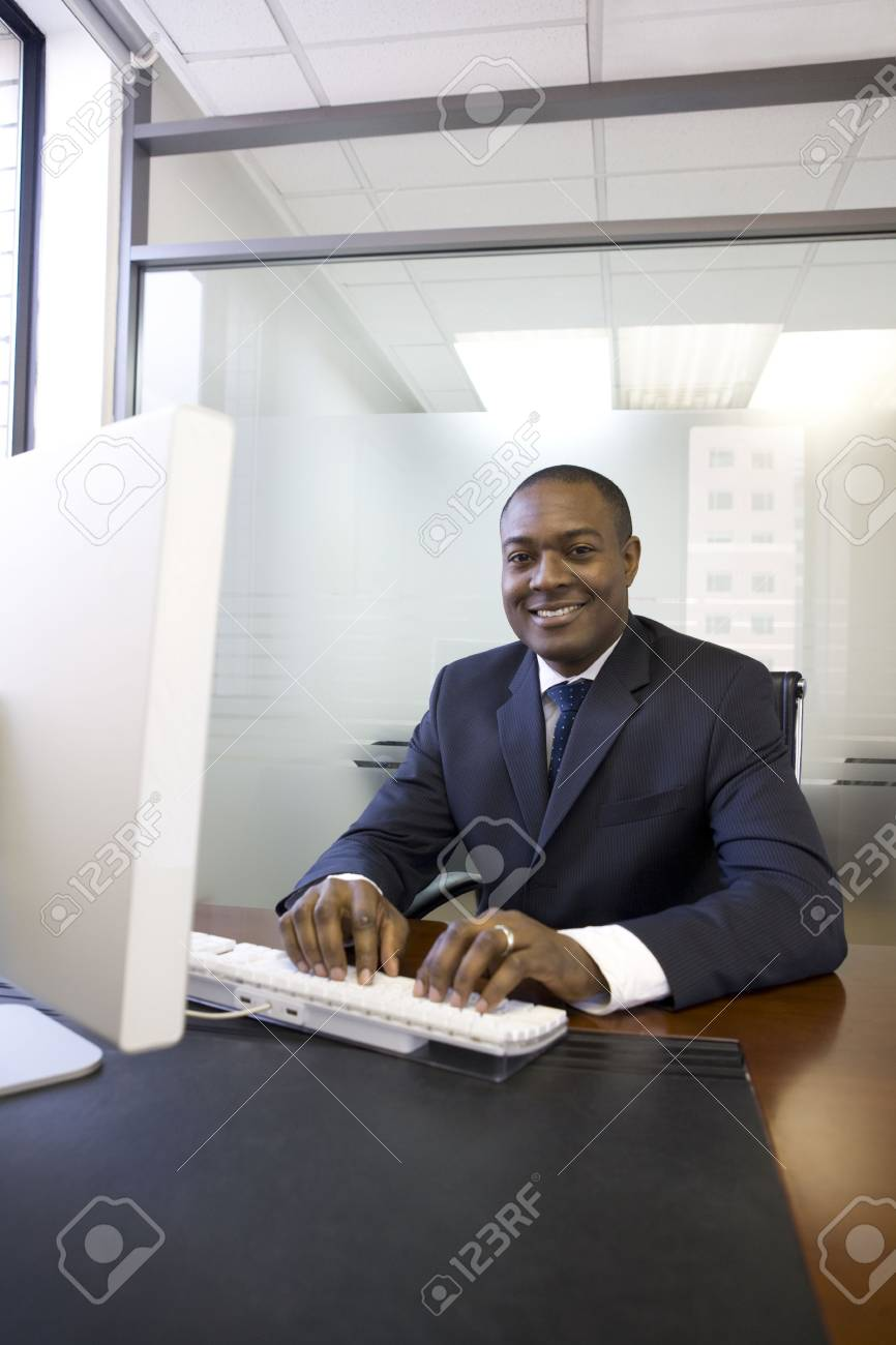 Businessman typing on computer keyboard Stock Photo - 4518467