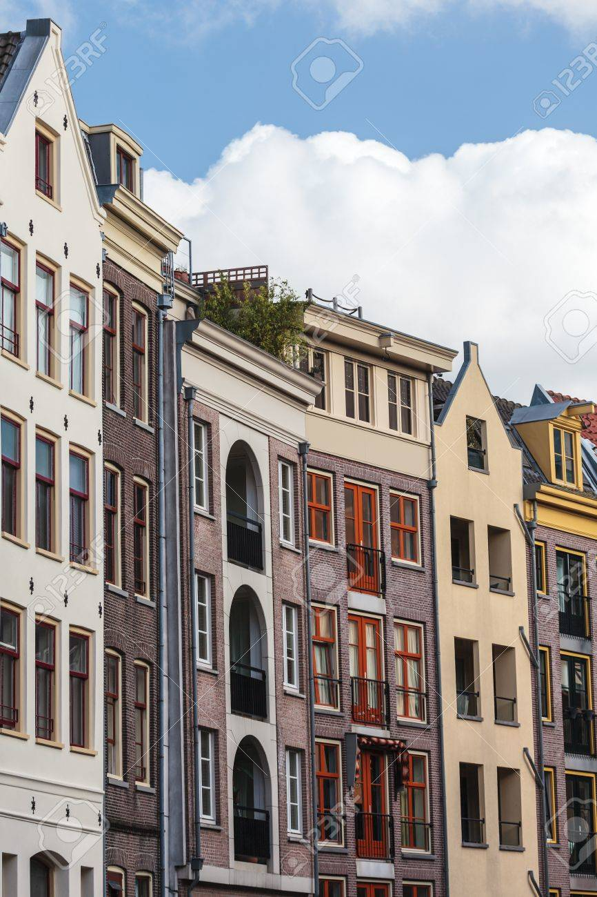 Row of old historic and modern designed canal houses in Amsterdam Stock Photo - 14962539