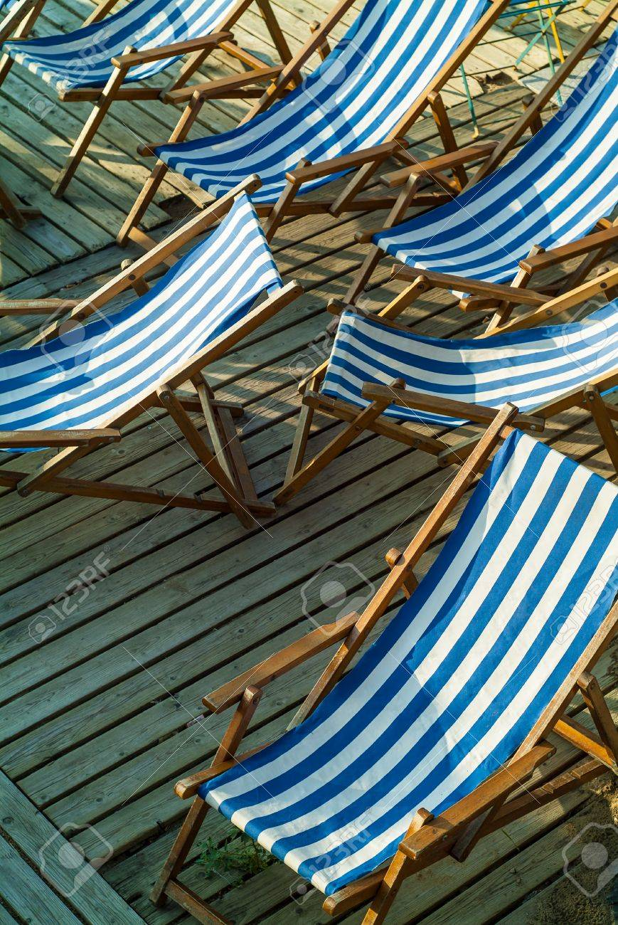 Miraculous Row Of Empty Blue And White Striped Beach Chairs On A Wooden Caraccident5 Cool Chair Designs And Ideas Caraccident5Info