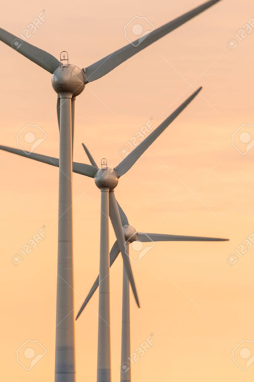 Row of wind turbines during an orange summer sunset Stock Photo - 16627665