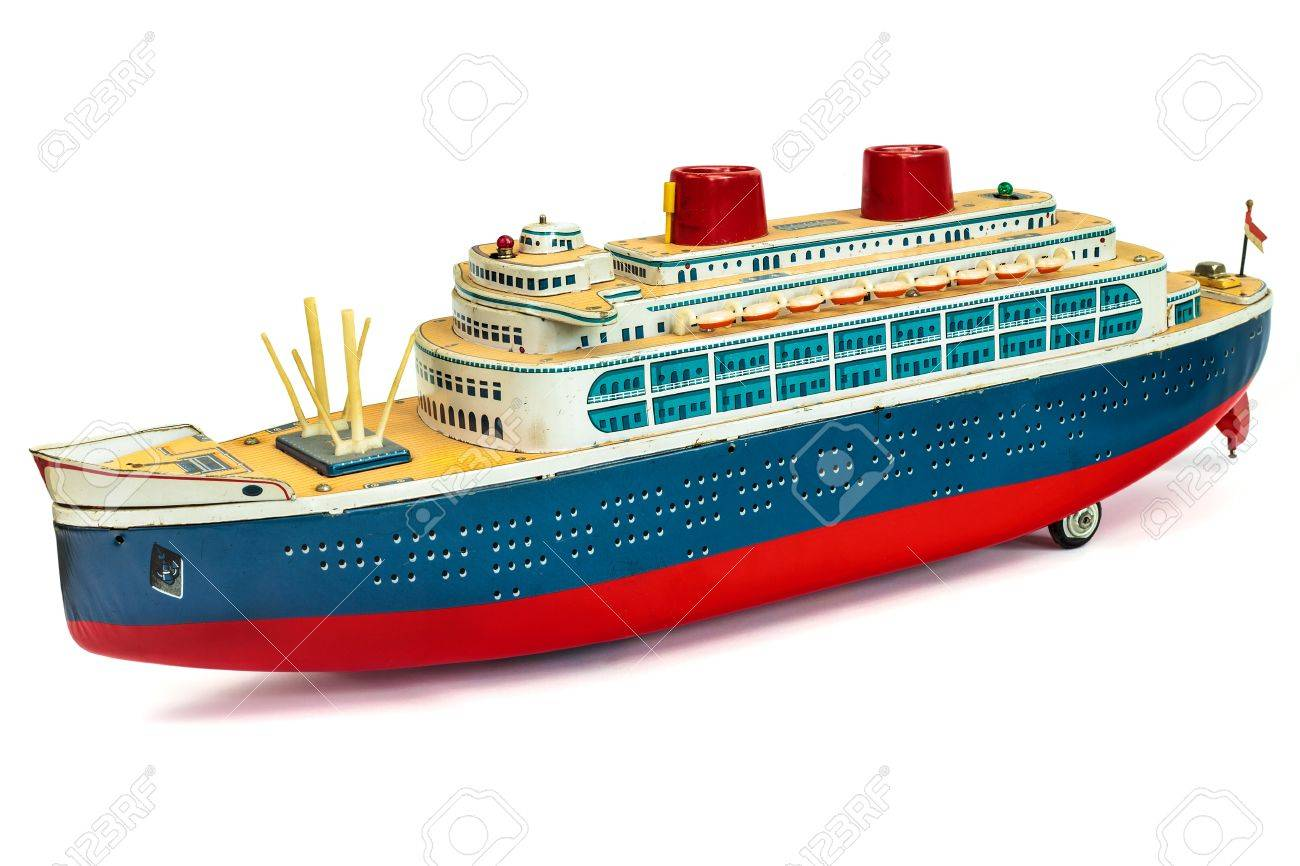 antique toy cruise ship isolated on a white background stock photo