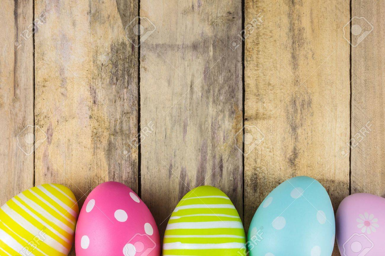 dyed colorful easter eggs on a vintage wooden background stock