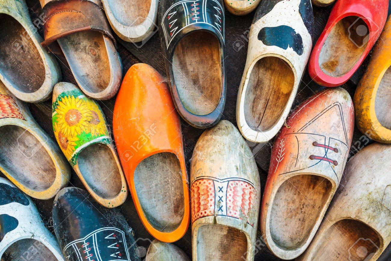 set of different colorful vintage dutch wooden clogs stock photo