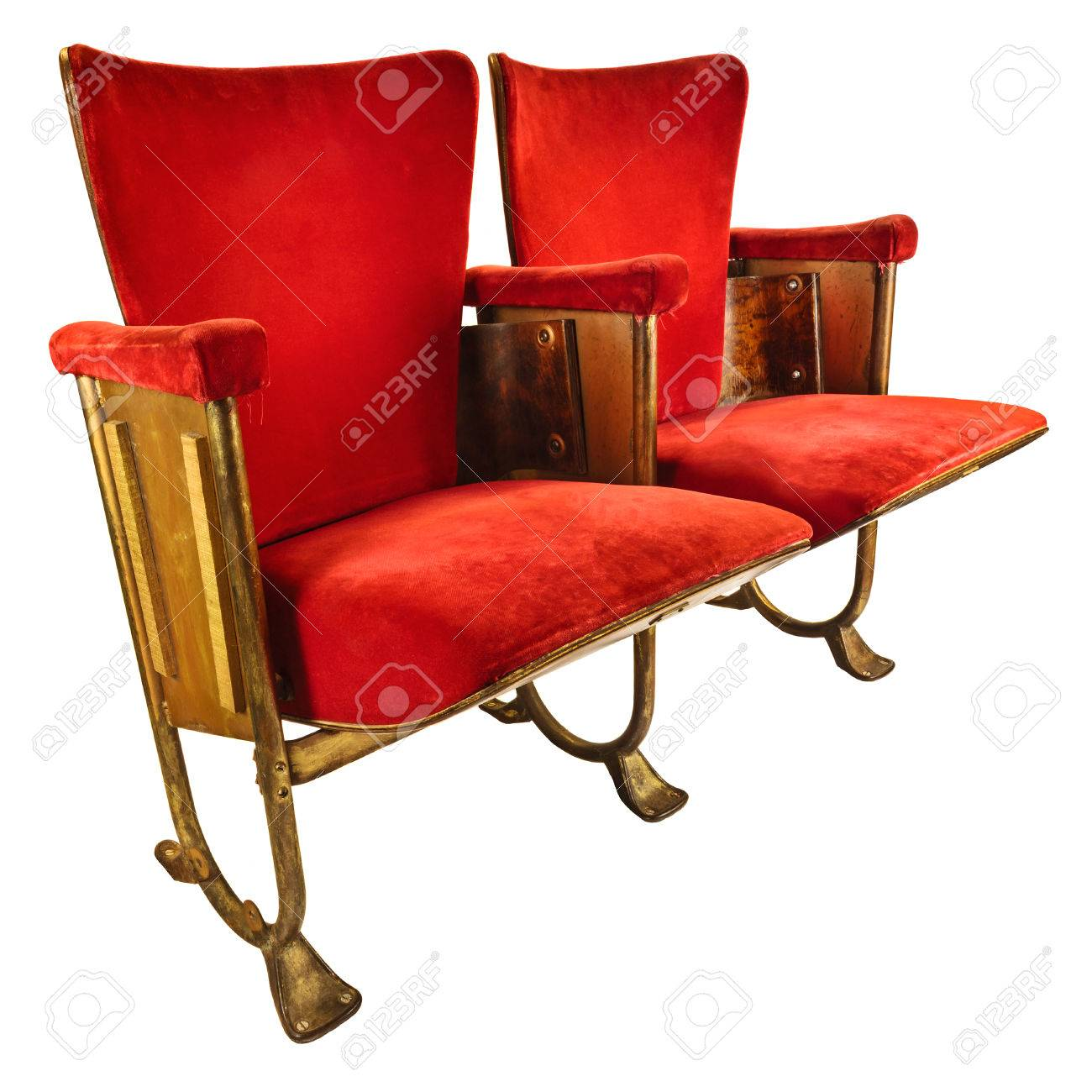stock photo two vintage red movie theater chairs isolated on a white background