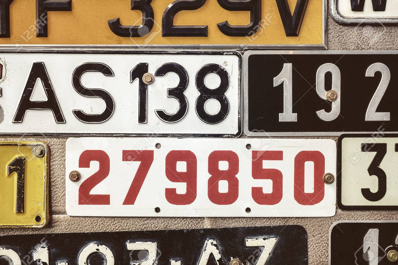 Sepia Toned Image Of Old Number Plates On A Metal Garage Door ...