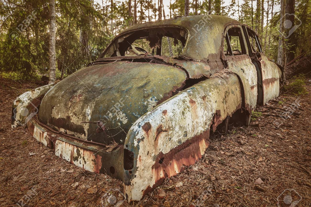 Retro Styled Image Of An Old Rusted And Weathered Scrap Car In ...