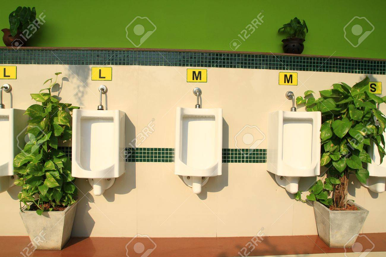 A Row Of Urinals In Decorate Wall At Public Men Toilet Room Stock ...