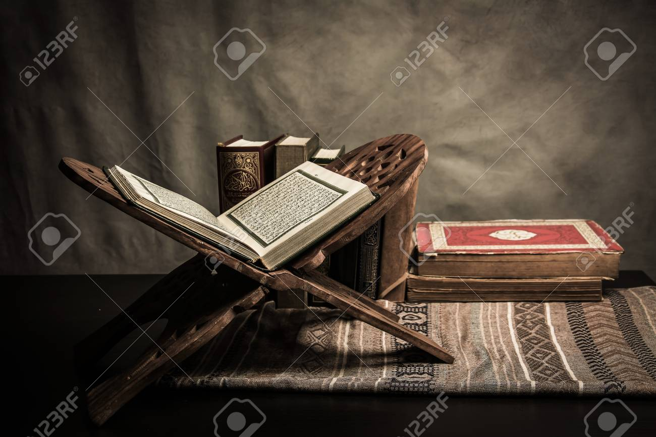 Koran - holy book of Muslims ( public item of all muslims ) on the table , still life . - 88322819