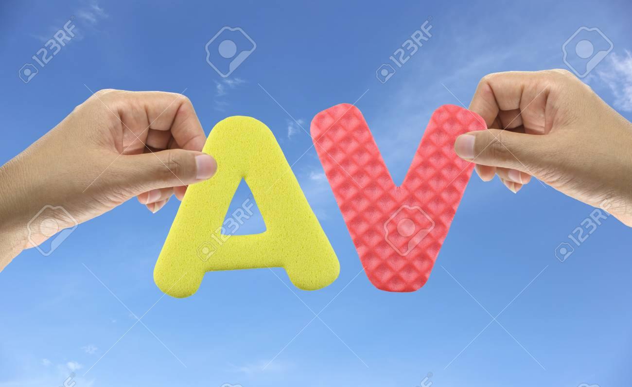 hand arrange alphabet av of acronym adult video very popular.. stock