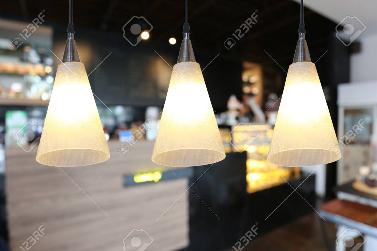 Warm lighting modern ceiling lamps in the cafe and interior decoration..