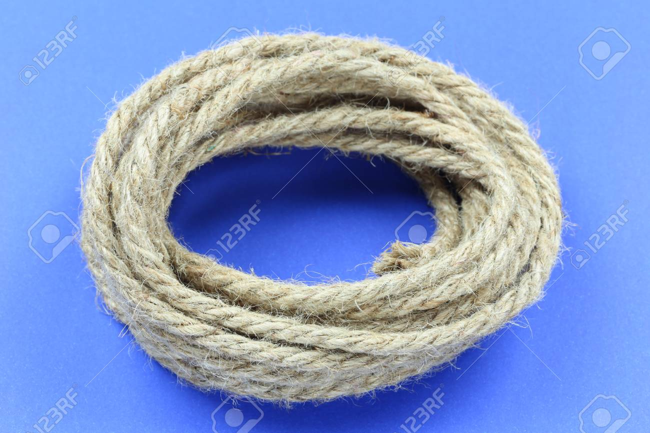 Pile Hemp Rope On Blue Paper Background And Have Copy Space For Stock Photo Picture And Royalty Free Image Image 116213497