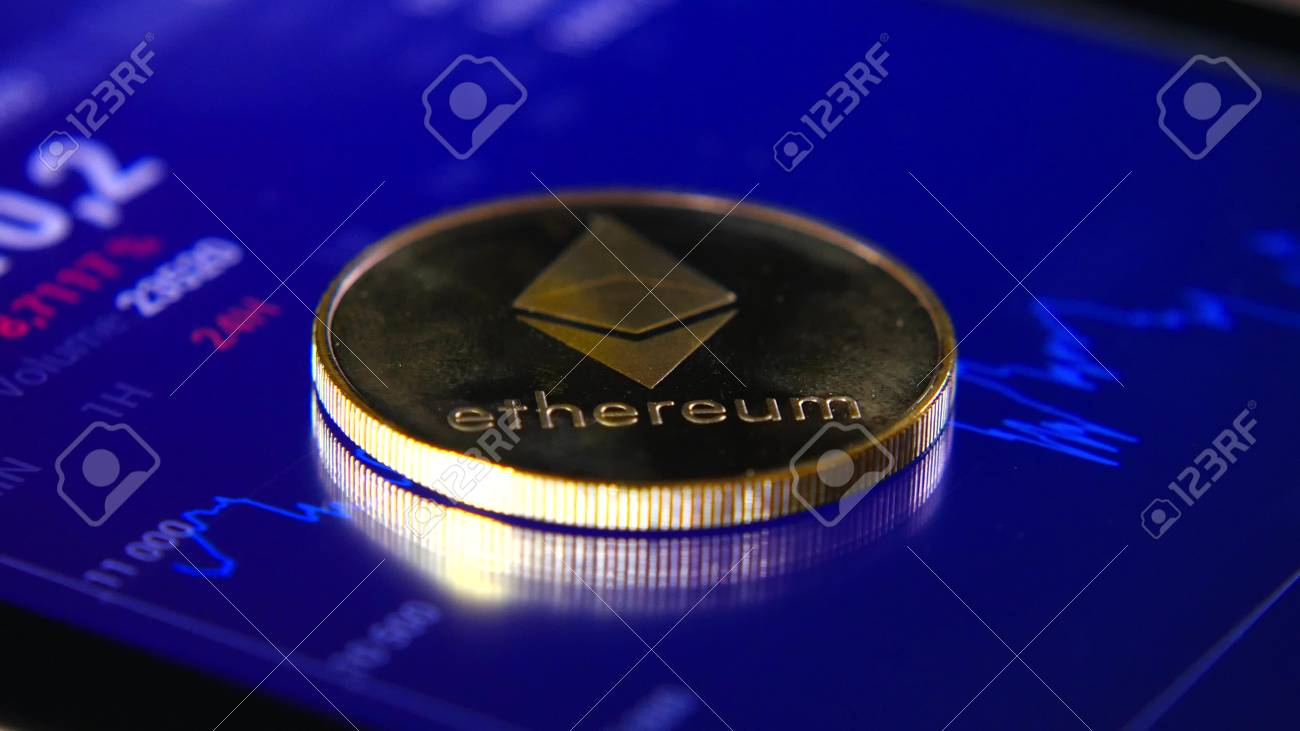 Gold coins of the ethereum on the background of a graphic stock chart. The Concentration of the Crypto-Currency of Virtual Money - 98230895