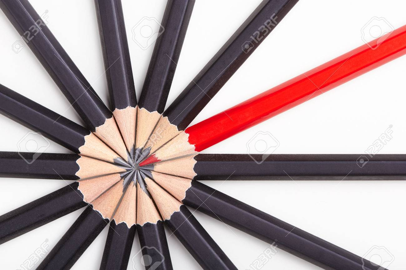 Red pencil standing out from crowd of plenty identical black fellows on white table. Leadership, uniqueness, independence, initiative, strategy, dissent, think different, business success concept - 47107532