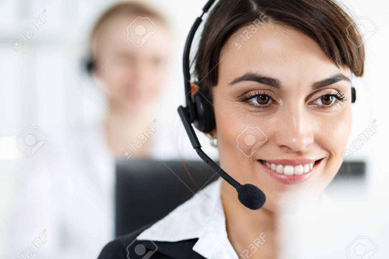 Female call center service operator at work. - 47107414