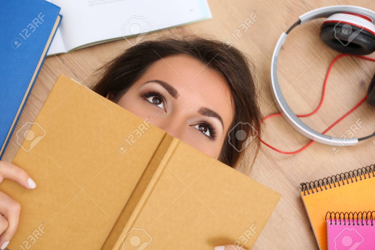 <b>floor covering</b>: Beautiful woman lying on <b>floor covering</b> face with book ... - 47986685-Beautiful-woman-lying-on-floor-covering-face-with-book-dreaming-Female-student-studying-using-textbo-Stock-Photo