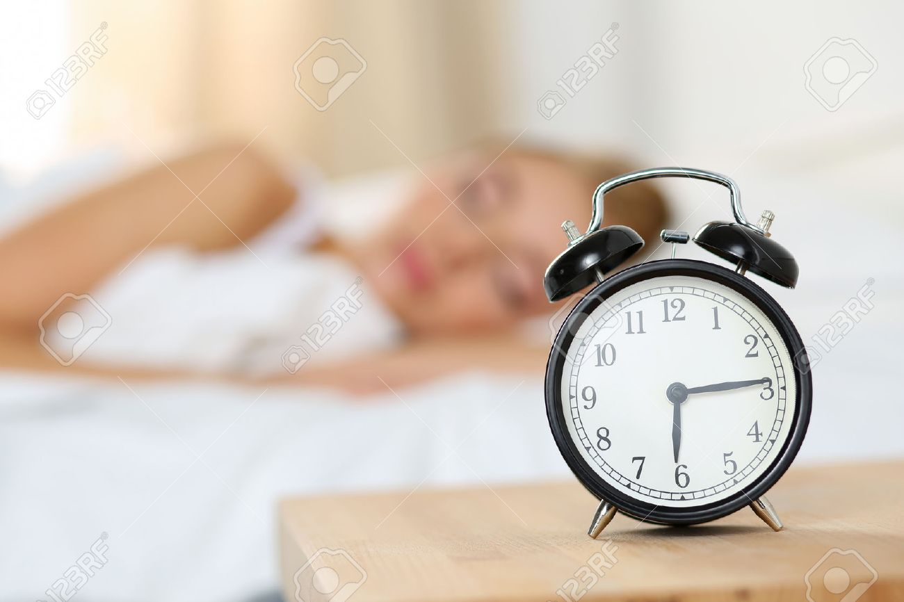Simple Alarm Bedside - 49108184-alarm-clock-standing-on-bedside-table-going-to-ring-early-morning-to-wake-up-woman-in-bed-sleeping-i  Trends_59730.jpg