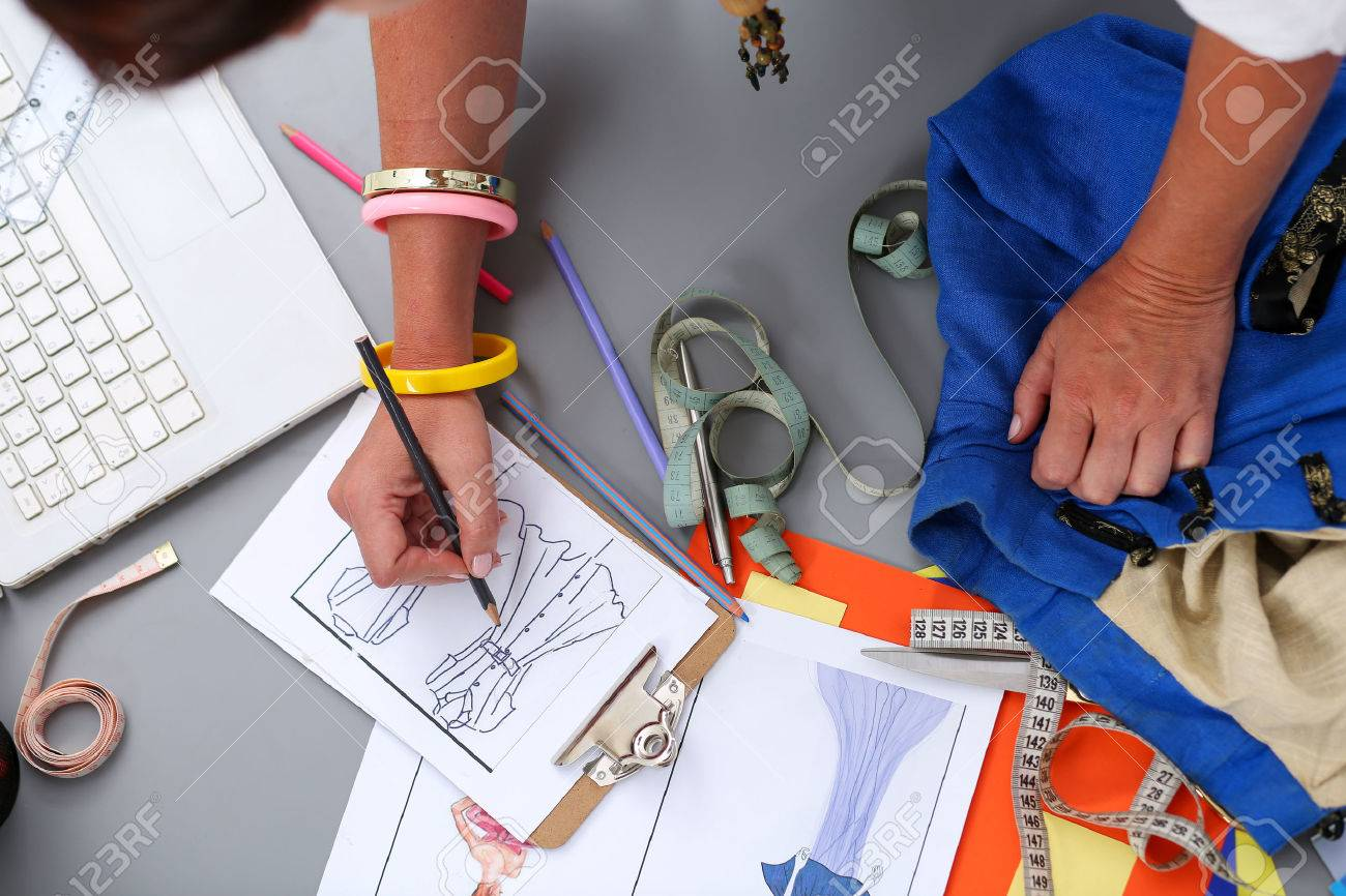 Female Fashion Designer Hands Holding Drawing Pad And Pen Making Stock Photo Picture And Royalty Free Image Image 54751352