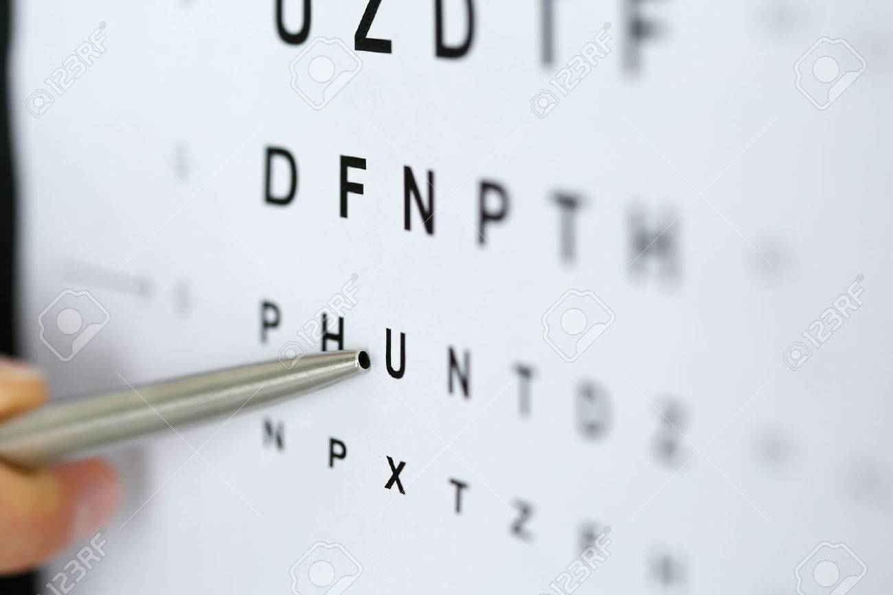 Silver ballpoint pen pointing to letter in eyesight check table. Sight test and correction, excellent vision or optician shop, laser surgery alternative, driver health certificate examination concept - 56354678