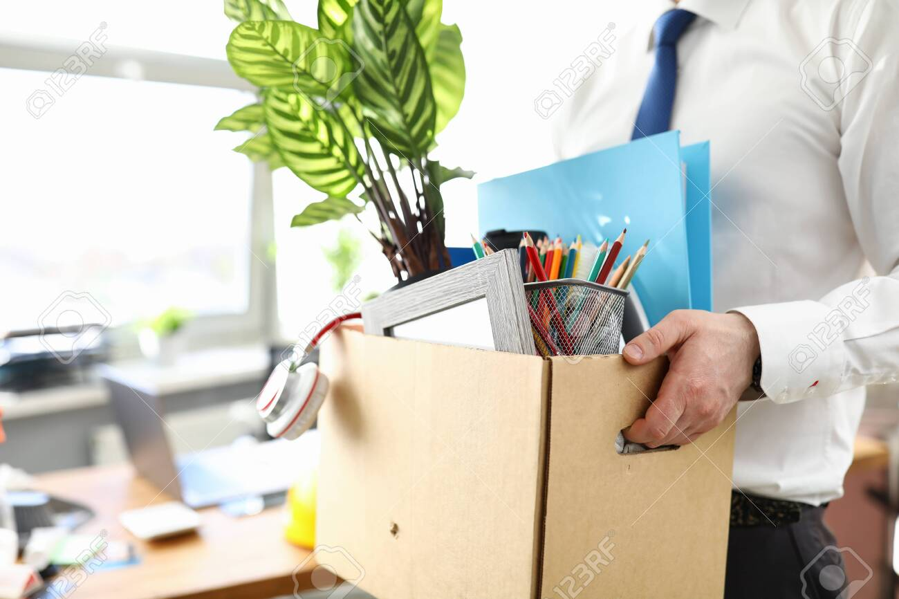 Businessman got fired during covid economy recession and taking his property out from office close-up - 149629493