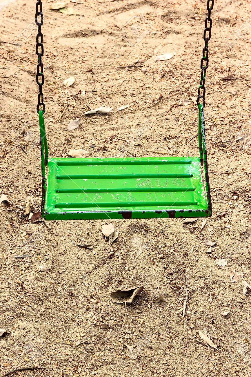 The swing in park for kids play it have green. Stock Photo - 19469627