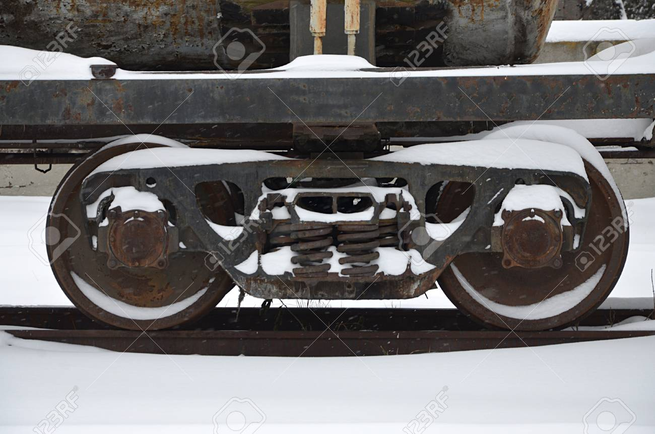 Detailed photo of snowy frozen railway freight car  A fragment