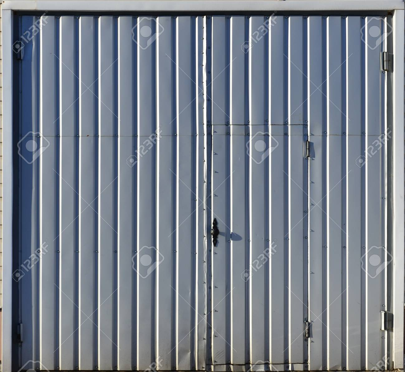 metal door texture. Stock Photo - The Texture Of Brown Corrugated Metal Door With A Colored Frame. Street Gate Iron Sheets, Fortified Small Screws.