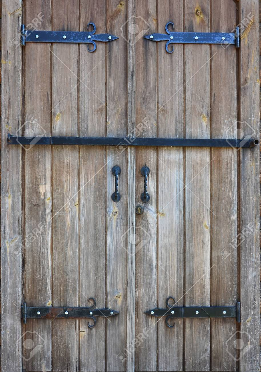 Stock Photo - The texture of an antique wooden door from the 16th and 17th  century. Ancient gates made of wooden boards, reinforced with metal forged  ... - The Texture Of An Antique Wooden Door From The 16th And 17th.. Stock