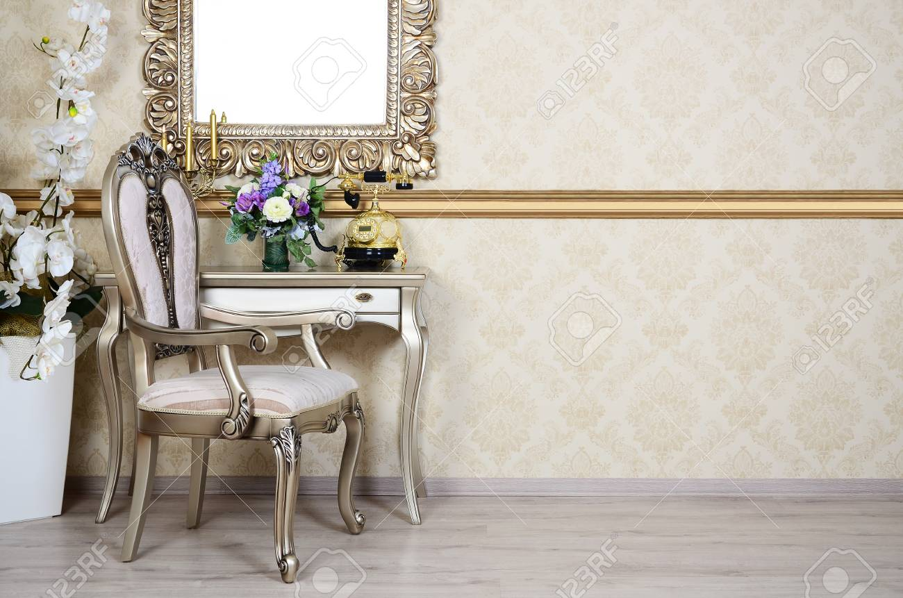 A Fragment Of A Retro Interior With A Chair And Table, On Which Is A