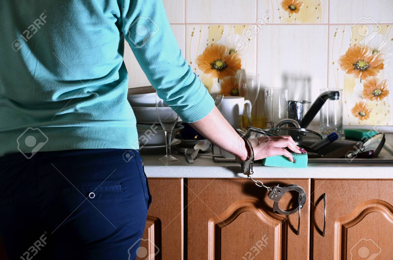 A Girl With A Sponge In Her Hand, Handcuffed To The Kitchen Counter ...
