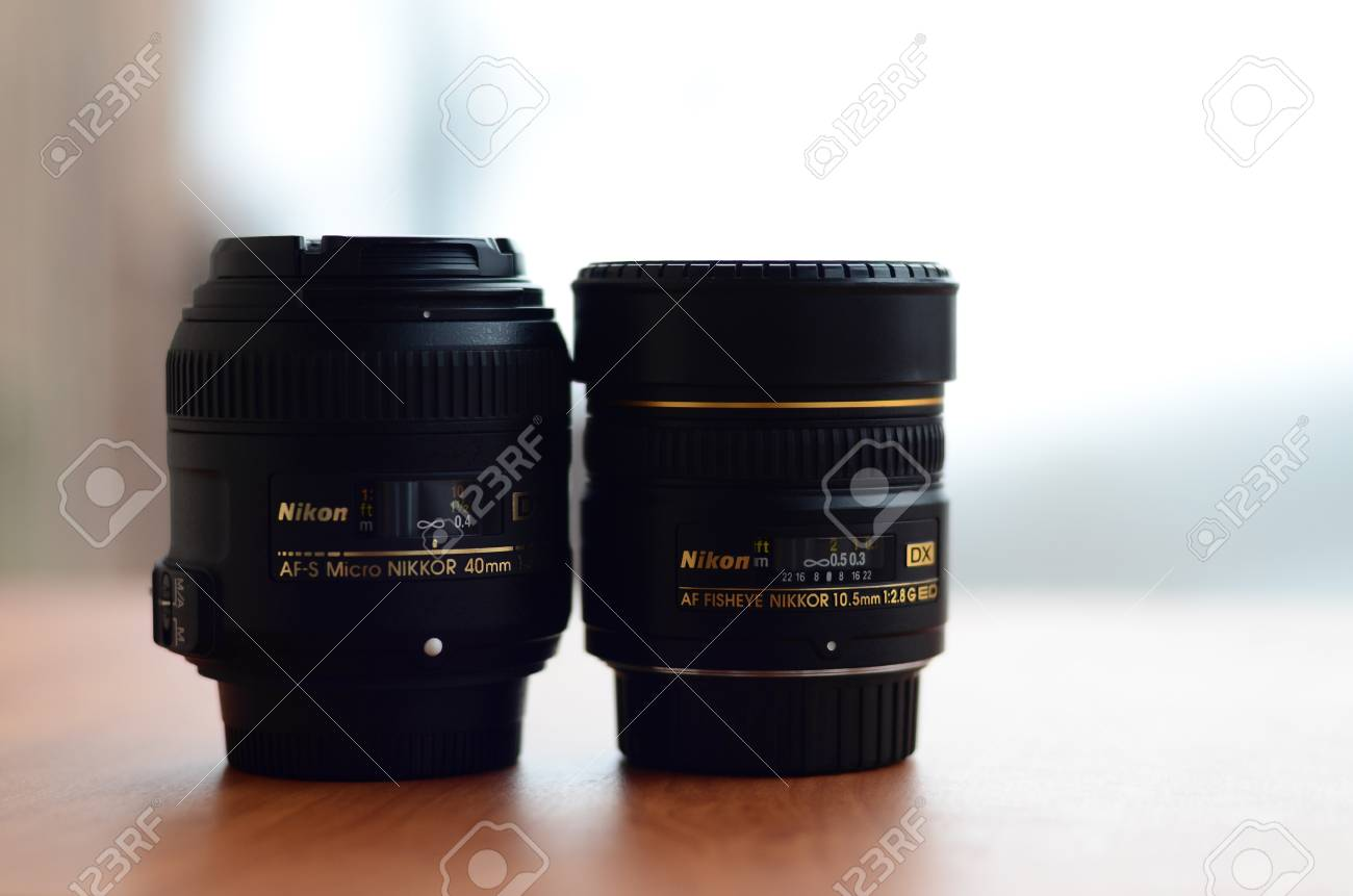 Kharkov Ukraine December 28 2017 Two Photographic Lenses Nikon Af 105mm F 28g If Ed Dx Fisheye Stock Photo Lie On A Wooden Table S Micro Nikkor 40mm 128g And