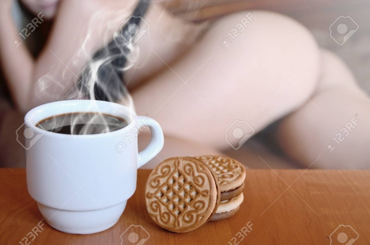 96481646-a-cup-of-hot-coffee-and-round-cookies-with-a-silhouette-of-a-sexy-girl-in-black-underwear-in-the-bac.jpg