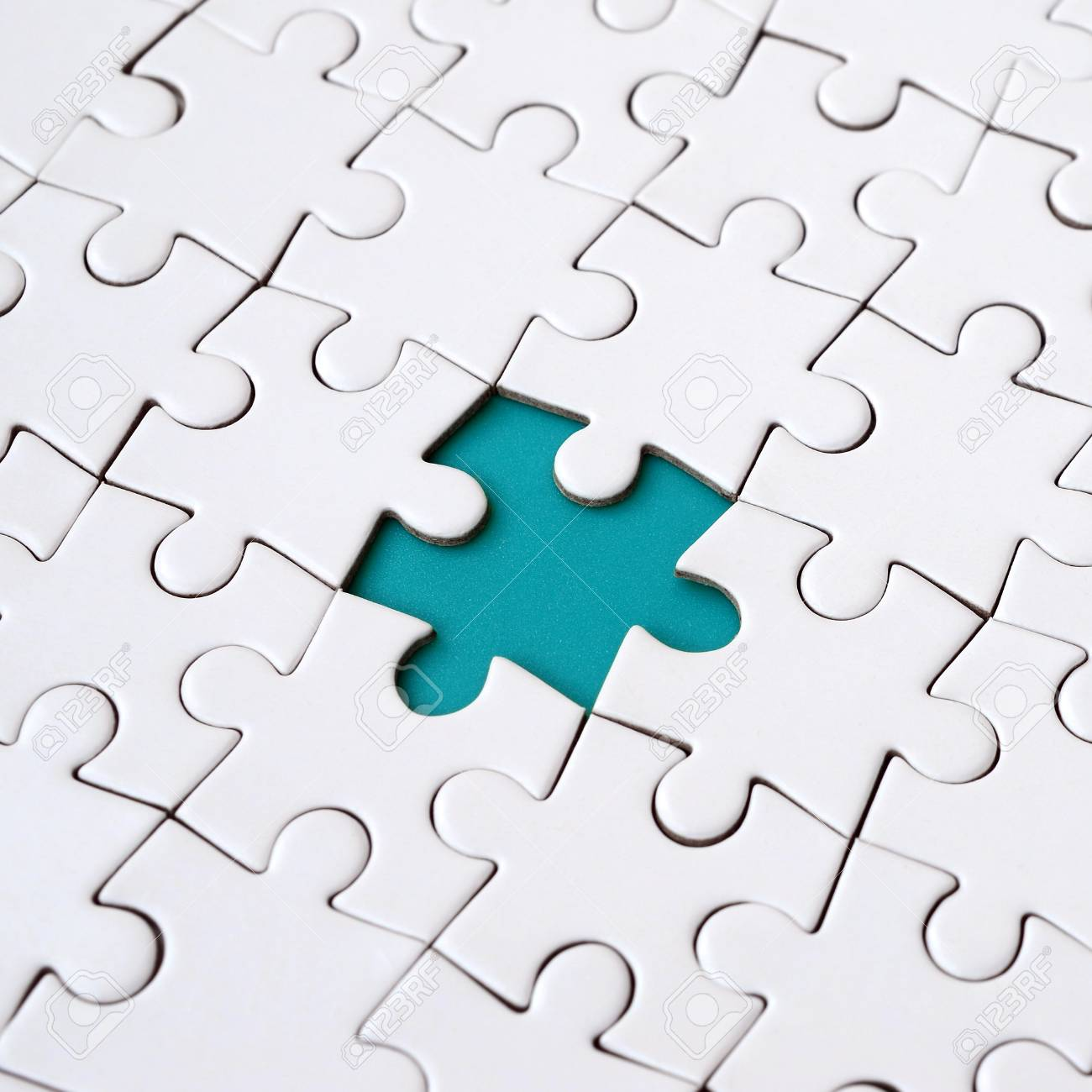 Close Up Texture Of A White Jigsaw Puzzle Inembled State With Missing Elements Forming