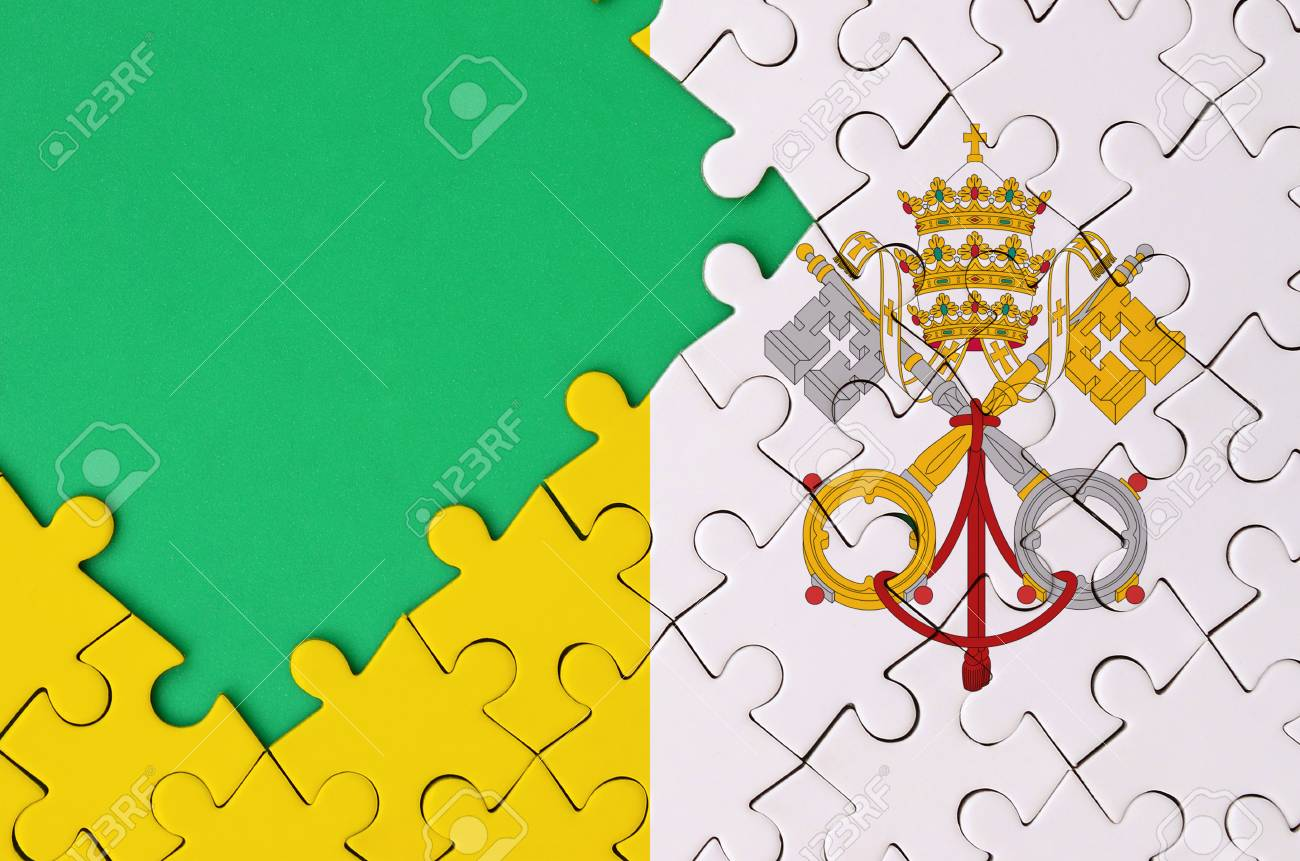 Stock P O Vatican City State Flag Is Depicted On A Completed Jigsaw Puzzle With Free Green Copye On The Left Side