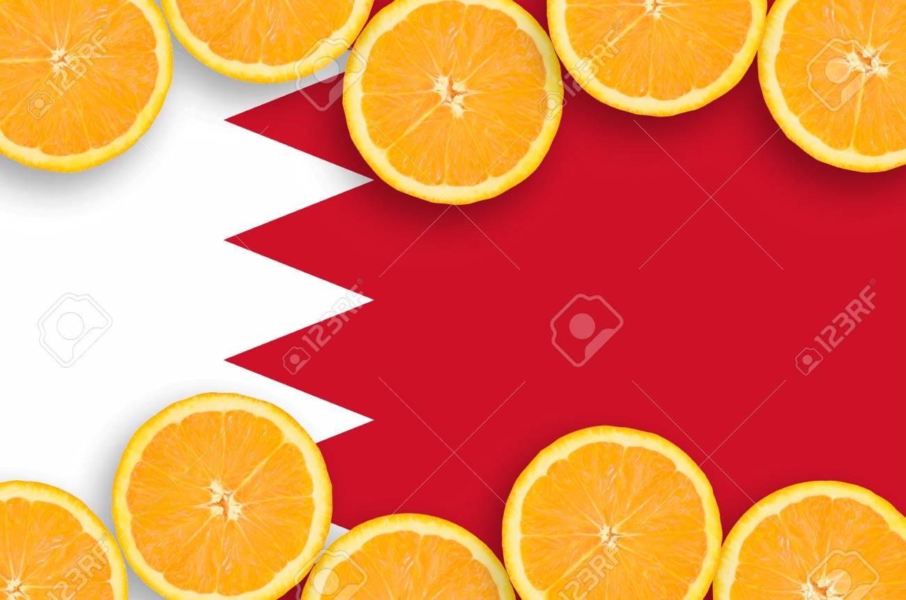 Bahrain flag in horizontal frame of orange citrus fruit slices