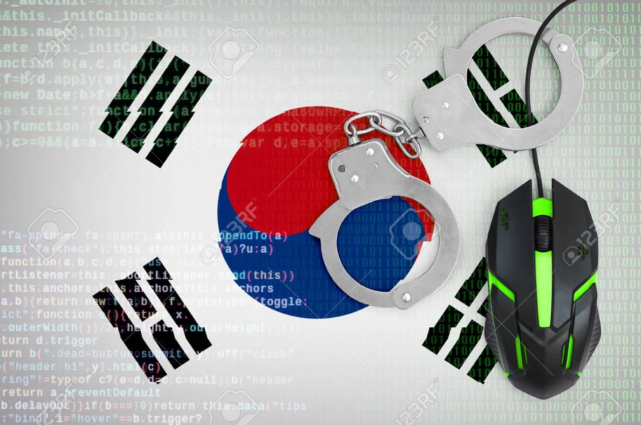 South Korea flag and handcuffed modern backlit computer mouse
