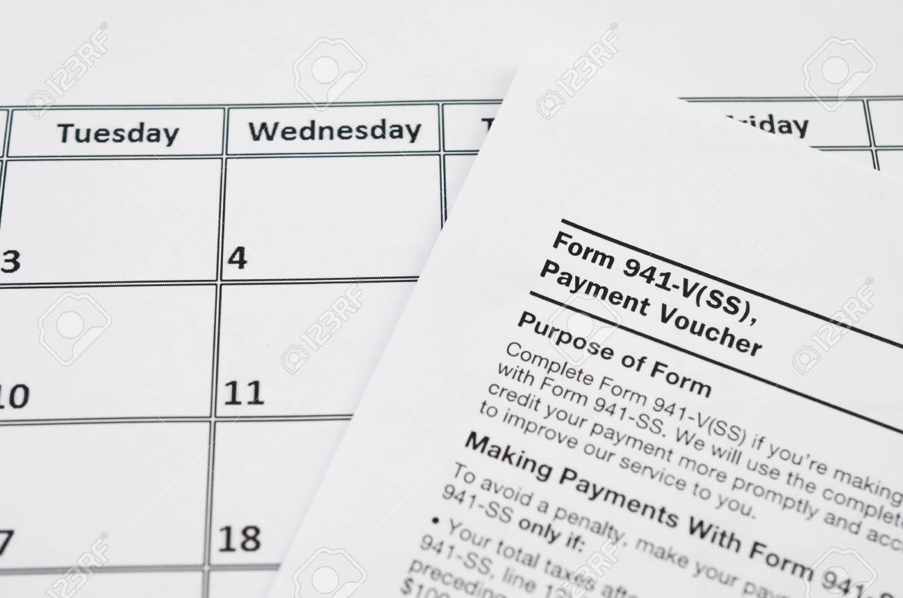941 form blank  IRS Form 13-V Payment Voucher blank lies on empty calendar page...