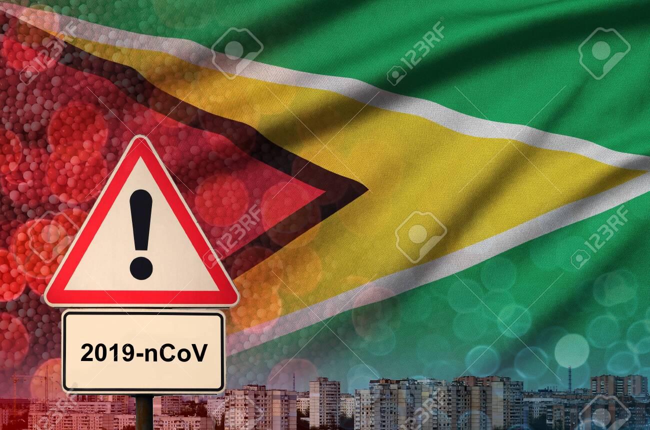 Guyana flag and virus 2019-nCoV alert sign. - 139167827