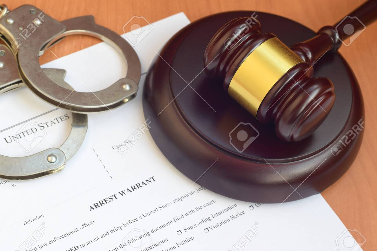 Justice mallet and arrest warrant blank document with police handcuffs close up - 143999651