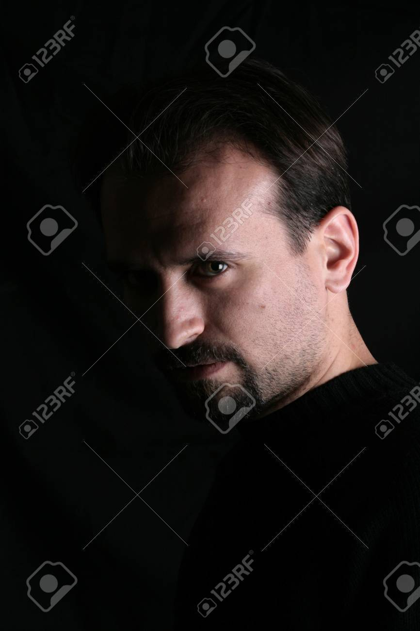 Portrait of a handsome young man on black background Stock Photo - 8747618